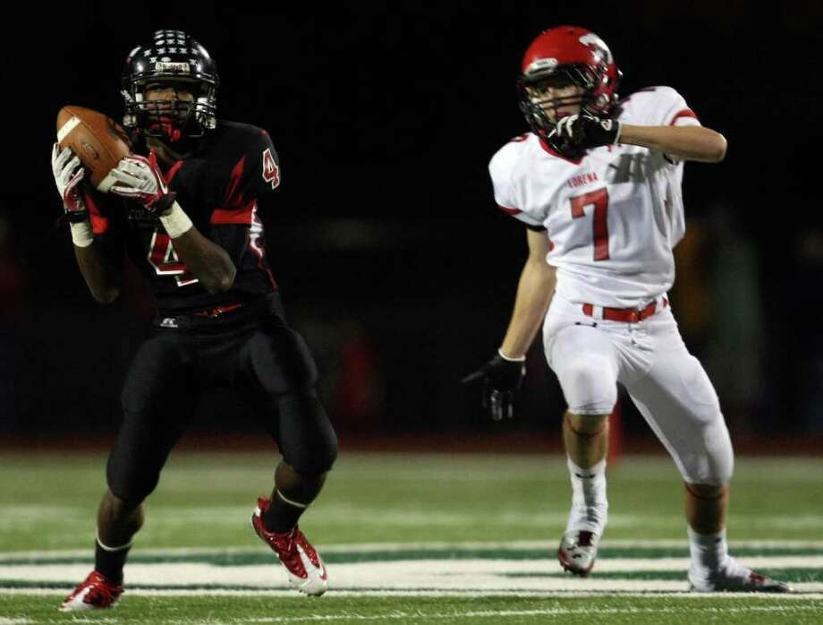 Coldspring's Jerrell Sykes (left) intercepts a pass intended for Lorena's Cory Wilson during the second half of their 3A Division II Region III semifinal, Friday, November 25, 2011 at Cubs Stadium in Brenham. Photo: Eric Christian Smith, For The Chronicle