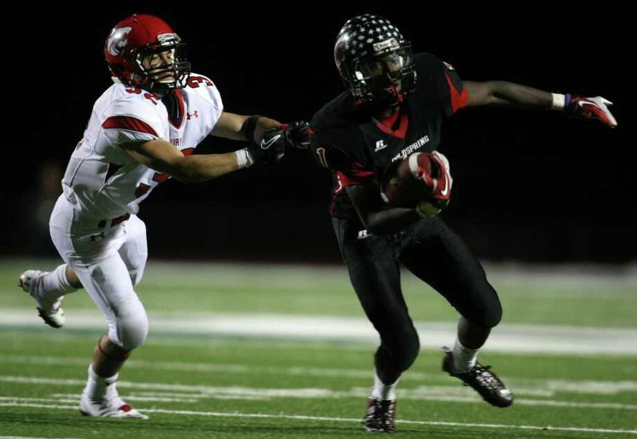 Coldspring's Sherman Gilbert (right) escapes the tackle of Lorena's Eric Bacerra during the second half of their 3A Division II Region III semifinal, Friday, November 25, 2011 at Cubs Stadium in Brenham. Photo: Eric Christian Smith, For The Chronicle