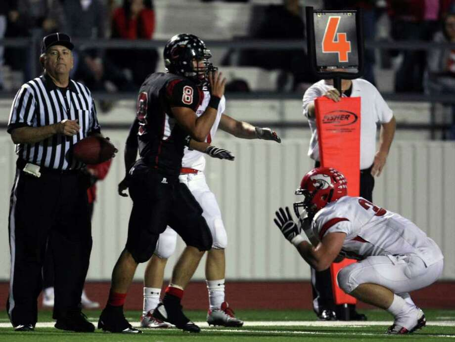Lorena's Jakob Coker (right) pleads with an official on a possession overturn during the second half of their 3A Division II Region III semifinal against Coldspring, Friday, November 25, 2011 at Cubs Stadium in Brenham. Photo: Eric Christian Smith, For The Chronicle