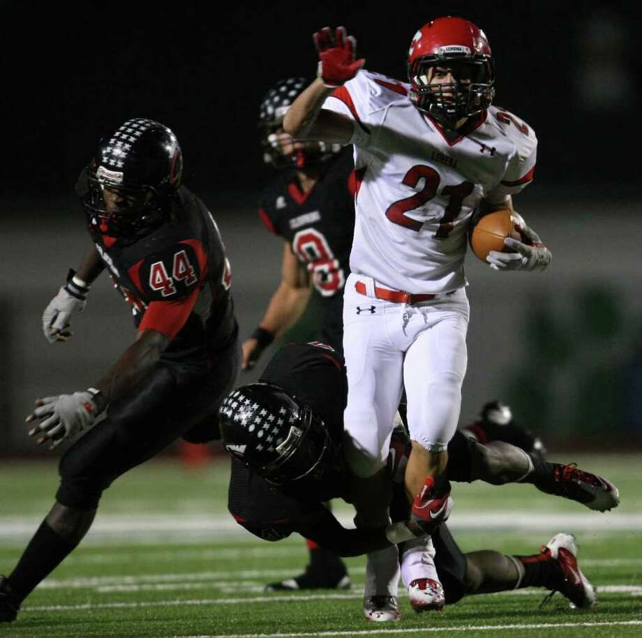 Lorena's Bradly Krall (21) is tackled by Coldspring's Jerrell Sykes during the second half of their 3A Division II Region III semifinal, Friday, November 25, 2011 at Cubs Stadium in Brenham. Photo: Eric Christian Smith, For The Chronicle