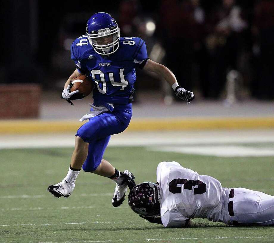 La Vernia's Levi Andrews (84) avoids the tackle attempt by Columbia's Floyd Bess (3) during the Class 3A Division 1 regional semifinals between Columbia and La Vernia November 25, 2011 at the Berry Center in Cypress, Texas. Columbia defeated La Vernia 28-7. Photo: Bob Levey, Houston Chronicle / ©2011 Bob Levey