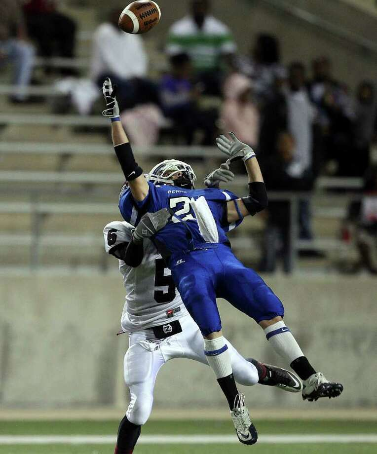 La Vernia's Kenny Moehrig (2) can't quite come down with the pass as he is defended by Columbia's  Kevin Brown (5) during the Class 3A Division 1 regional semifinals between Columbia and La Vernia November 25, 2011 at the Berry Center in Cypress, Texas. Columbia defeated La Vernia 28-7. Photo: Bob Levey, Houston Chronicle / ©2011 Bob Levey