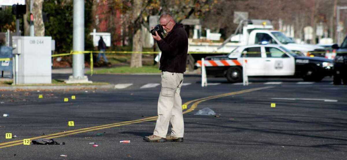 Stratford police investigate a hit and run at the intersection of Main Street and Stratford Avenue Saturday morning.