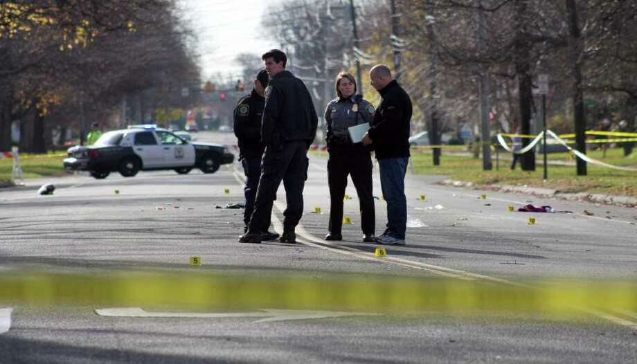 Stratford police investigate a hit and run at the intersection of Main Street and Stratford Avenue Saturday morning. Photo: Jeff Bustraan / Connecticut Post