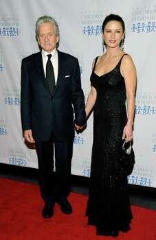 "Actor Michael Douglas and wife actress Catherine Zeta-Jones attend the ""Children At Hope"" gala dinner at Pier Sixty in New York Nov. 21. The Bedford Hills, N.Y., residents were spotted having dinner last week at the Bedford Post, owned by Pound Ridge, N.Y., resident Richard Gere. (AP Photo/Evan Agostini) Photo: Evan Agostini, Associated Press / AGOEV"