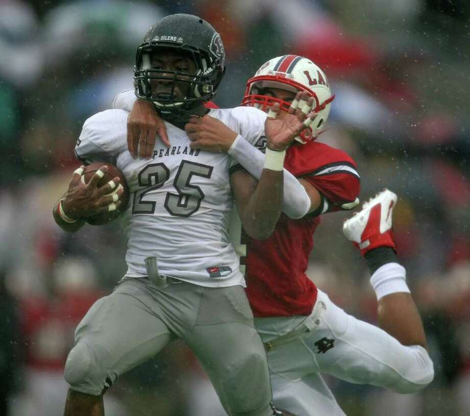 Pearland's Jackie Robinson (25) is tackled by Lamar's John Bonney during the first half of the 5A Division I Region III semifinal, Saturday, November 26, 2011 at Galena Park Stadium in Houston. Photo: Eric Christian Smith, For The Chronicle