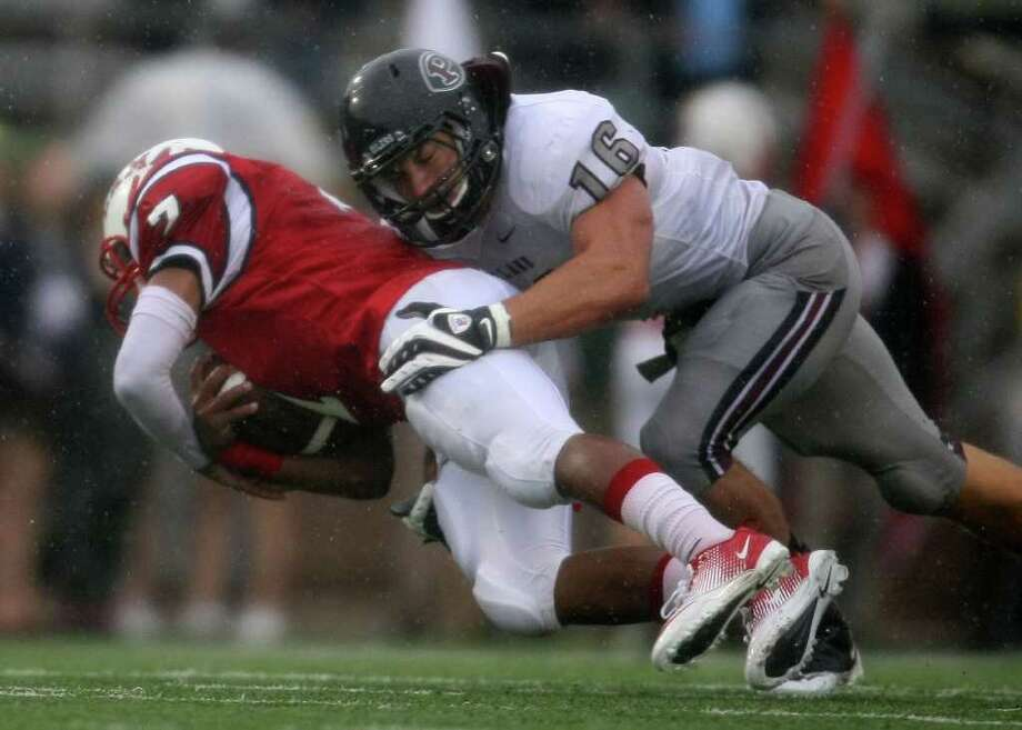 Lamar's Darrell Colbert (7) is sacked by Pearland's Kendall Ehrlich during the first half of the 5A Division I Region III semifinal, Saturday, November 26, 2011 at Galena Park Stadium in Houston. Photo: Eric Christian Smith, For The Chronicle