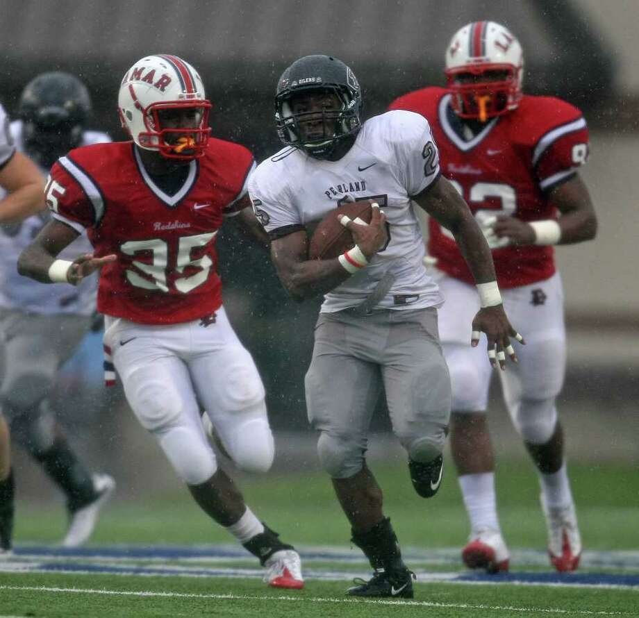 Pearland's Jackie Robinson (25) speeds past Lamar's Nathaniel Mayberry (35) during the first half of the 5A Division I Region III semifinal, Saturday, November 26, 2011 at Galena Park Stadium in Houston. Photo: Eric Christian Smith, For The Chronicle