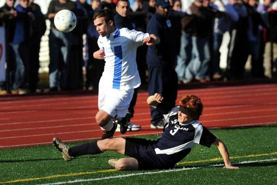 Bunnell's James Gillespie in action against Avon's Nick Drago during the Class L boys state championship game, in Middletown, Conn. Nov. 26th, 2011. Bunnell defeated Avon 3-0. Photo: Ned Gerard / Connecticut Post