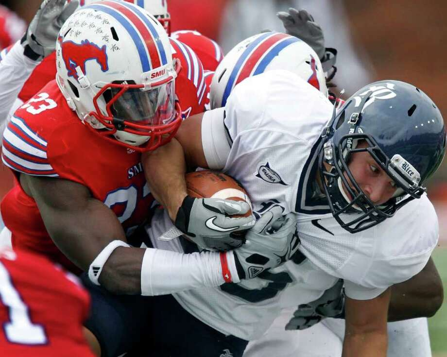 Nov. 26: SMU 27, Rice 24SMU DB Chris Banjo (23) tackles Rice WR Mario Hull (85) in the fourth quarter during the SMU Mustangs vs. the Rice Owls college football game at Gerald J. Ford Stadium in Dallas on Saturday, November 26, 2011. (Louis DeLuca/The Dallas Morning News) Photo: Louis DeLuca, Staff Photographer / Louis DeLuca/The Dallas Morning News