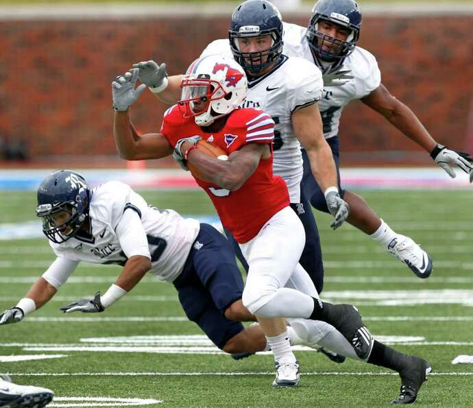 SMU WR Darius Johnson (3) breaks free from a pack of Rice defenders as he scores a touchdown in the