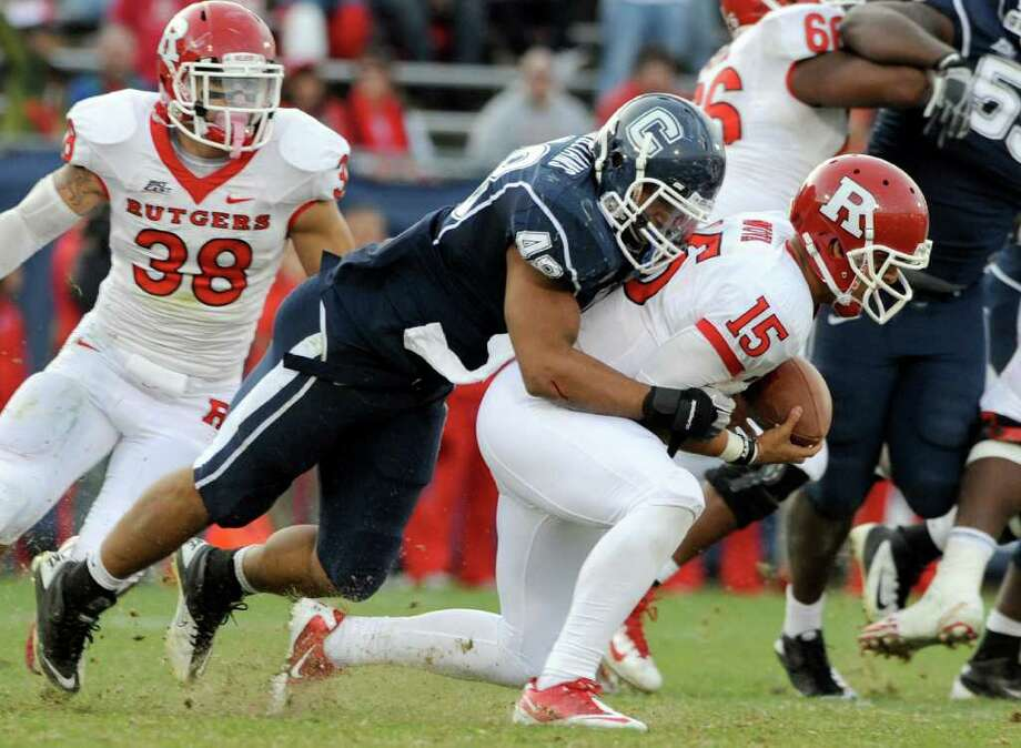 Connecticut's Trevardo Williams, left, sacks Rutgers quarterback Gary Nova during the second half of Connecticut's 40-22 victory in an NCAA college football game in East Hartford, Conn., on Saturday, Nov. 26, 2011. (AP Photo/Fred Beckham) Photo: Fred Beckham, Associated Press / FR153656 AP