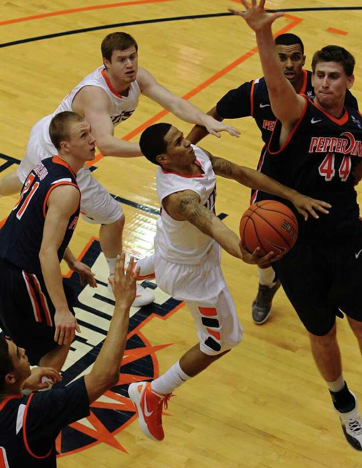 UTSA's Michael Hale, III (05) goes up for a shot against Pepperdine defenders including Corbin Moore (44) in men's college basketball at UTSA on Saturday, Nov. 26, 2011. UTSA loses to Pepperdine, 64-70, in overtime. Photo: KIN MAN HUI, ~ / SAN ANTONIO EXPRESS-NEWS