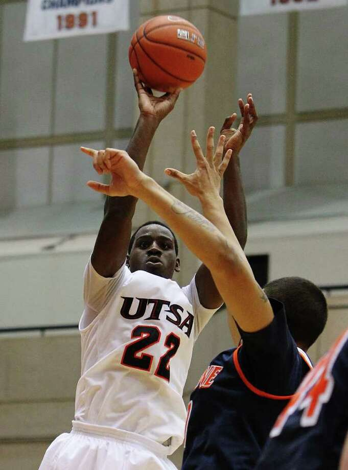 UTSA's Kannon Burrage (22) attempts a shot against Pepperdine's Taylor Darby (41) in men's college basketball at UTSA on Saturday, Nov. 26, 2011. UTSA loses to Pepperdine, 64-70, in overtime. Photo: KIN MAN HUI, ~ / SAN ANTONIO EXPRESS-NEWS