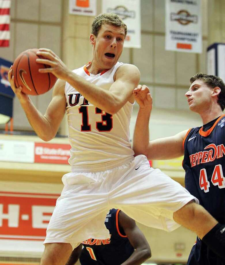 UTSA's Igor Nujic (13) grabs a rebound against Pepperdine's Corbin Moore (44) in men's college basketball at UTSA on Saturday, Nov. 26, 2011. UTSA loses to Pepperdine, 64-70, in overtime. Photo: KIN MAN HUI, ~ / SAN ANTONIO EXPRESS-NEWS