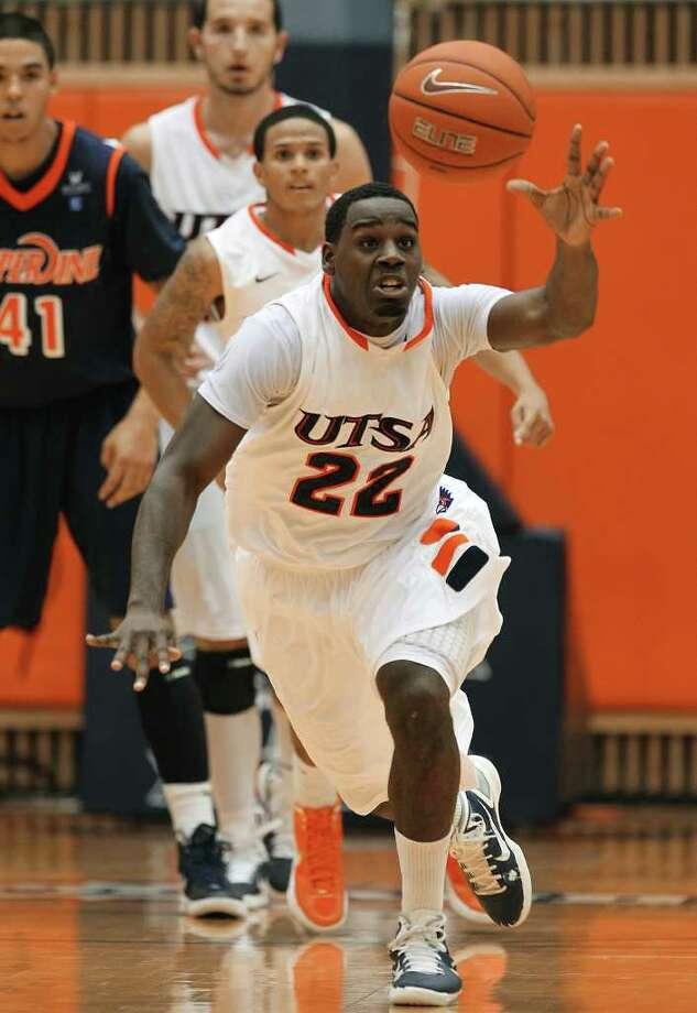 UTSA's Kannon Burrage (22) gets a steal against Pepperdine in men's college basketball at UTSA on Saturday, Nov. 26, 2011. UTSA loses to Pepperdine, 64-70, in overtime. Photo: KIN MAN HUI, ~ / SAN ANTONIO EXPRESS-NEWS
