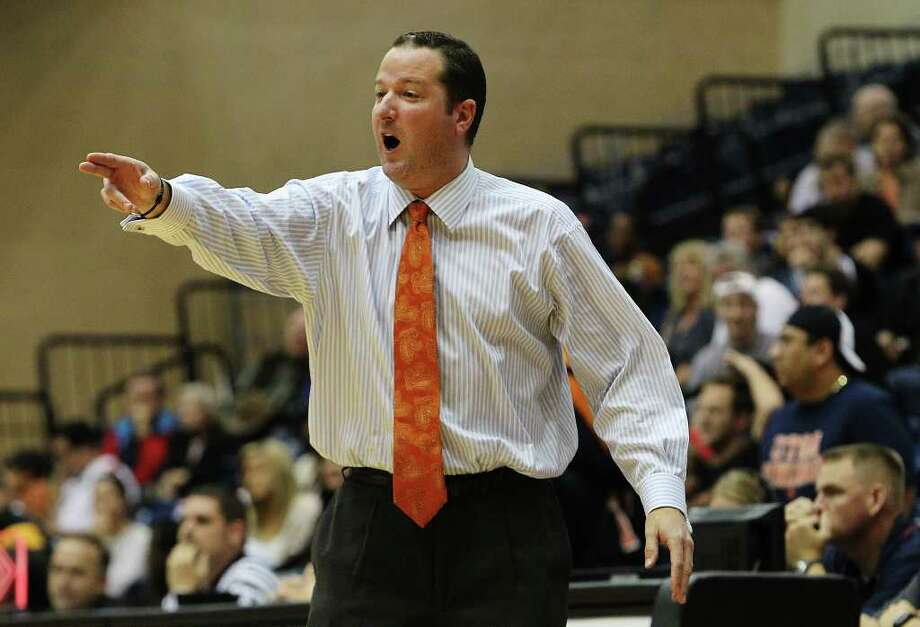 UTSA basketball coach Brooks Thompson objects to a call during the Roadrunner's game against Pepperdine at UTSA on Saturday, Nov. 26, 2011. UTSA loses to Pepperdine, 64-70, in overtime. Photo: KIN MAN HUI, ~ / SAN ANTONIO EXPRESS-NEWS