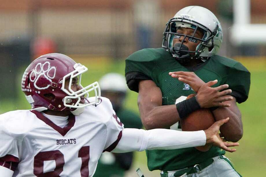 Hightower defensive back Kelsey Douglas (6) intercepts a pass intended for Cy-Fair wide receiver Kaleb Moore (81) during the first half in Class 5A Div. I Region III semifinal high school playoff action at Tully Stadium, Saturday, Nov. 26, 2011, in Houston. Photo: Smiley N. Pool, Houston Chronicle / © 2011  Houston Chronicle