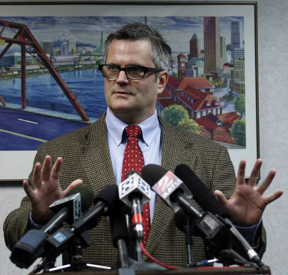 In this photo taken Nov. 14, 2011, Portland Mayor Sam Adams discuss Sunday's police raid on the Occupy Portland encampment in two downtown parks during a news conference, in Portland, Ore. As concerns over safety and sanitation grew at the encampments over the last month, officials from nearly 40 cities turned to each other on conference calls, sharing what worked and what hasn't as they grappled with the leaderless movement. (AP Photo/Rick Bowmer) Photo: Rick Bowmer / AP