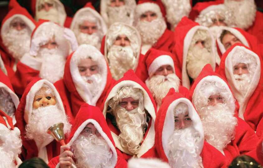 Volunteer Santas attend their annual meeting at the Komoedie am Kurfuerstedamm theater on November 2