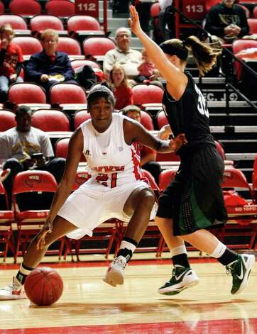 Western Kentucky's Alexis Govan, left, drives past Wright State's KC Elkins during a women's NCAA college basketball game on,Tuesday, Nov. 22, 2011 in Bowling Green, Ky. Photo: AP