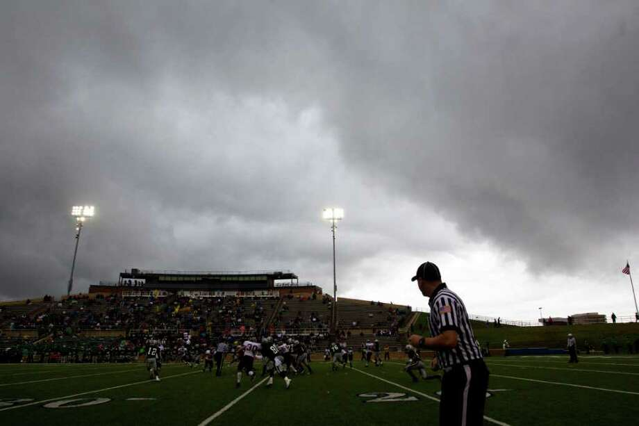 Dark storm clouds pass over Tully Stadium as Hightower faces Cy-Fair during the first half in a Class 5A Div. I Region III semifinal high school playoff game on Saturday, Nov. 26, 2011, in Houston. Photo: Smiley N. Pool, Houston Chronicle / © 2011  Houston Chronicle