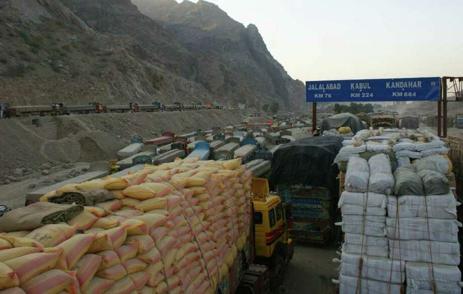 Trucks are parked at a road as authorities closed the Torkham border for NATO supply trucks at Pakistani border town of Torkham on Saturday, Nov 26, 2011. Pakistan on Saturday accused NATO helicopters of firing on two army checkpoints in the northwest and killing 25 soldiers, then retaliated by closing a key border crossing used by the coalition to supply its troops in neighboring Afghanistan. (AP Photo/Qazi Rauf) Photo: Qazi Rauf / AP