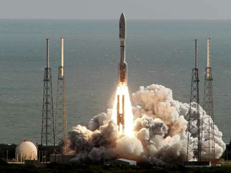 A United Launch Alliance Atlas V rocket carrying NASA's Mars Science Laboratory (MSL) Curiosity rover lifts off from Launch Complex 41 at Cape Canaveral Air Force Station in Cape Canaveral, Fla., Saturday, Nov. 26, 2011. The rocket will deliver a science laboratory to Mars to study potential habitable environments on the planet. (AP Photo/Terry Renna) Photo: Terry Renna / FR60642 AP