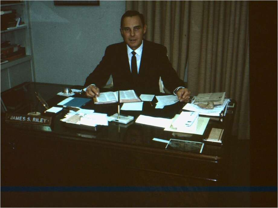 Dr. James Stewart Riley is shown working on a sermon.