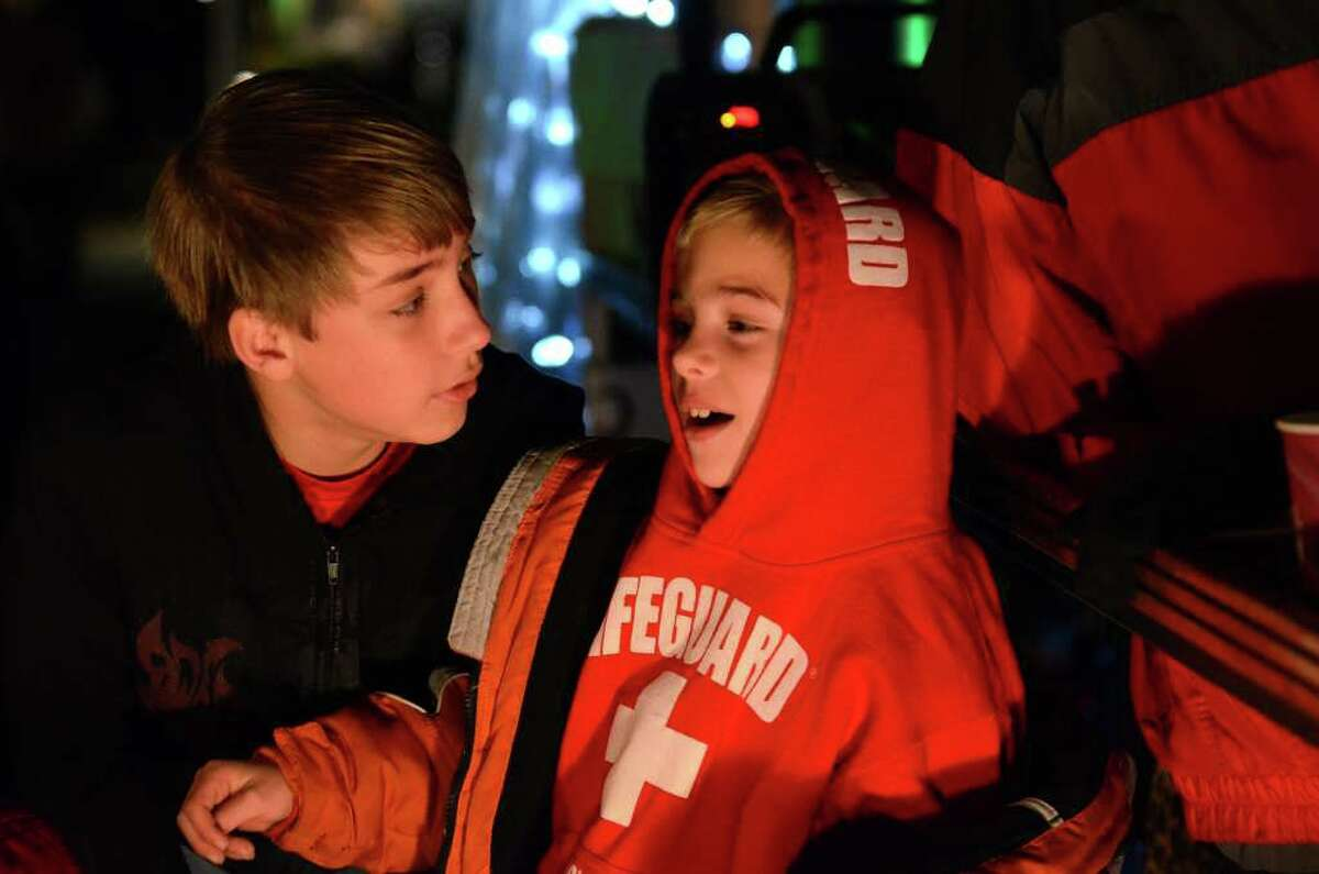 Michael Macari, 10, of Norwalk, and Jonathan Greco, 7, of Norwalk, sit on a bench at the Crabshell Restaurant, anxiously awaiting the arrival of the boat parade during the 6th annual Stamford Harbor Parade of Lights to benefit Toys for Tots and the Young Mariners Foundation at Harbor Point in Stamford on Saturday, Nov. 26, 2011.