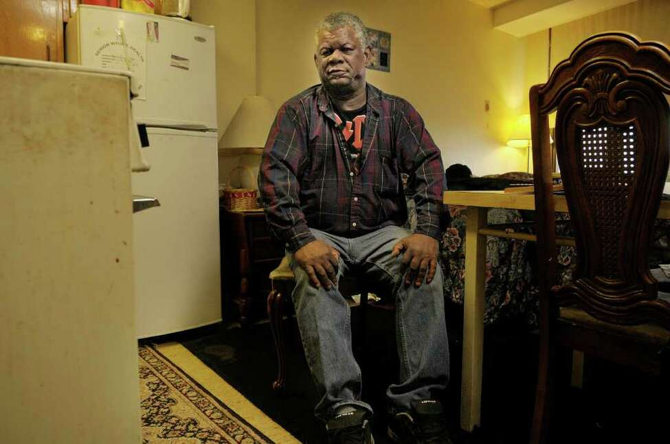 Kenneth Miller sits in his Albany apartment on Wednesday, Nov. 23, 2011. Miller, a legal permanent resident from Jamaica, is facing deportation due to his prior criminal convictions. (Paul Buckowski / Times Union)