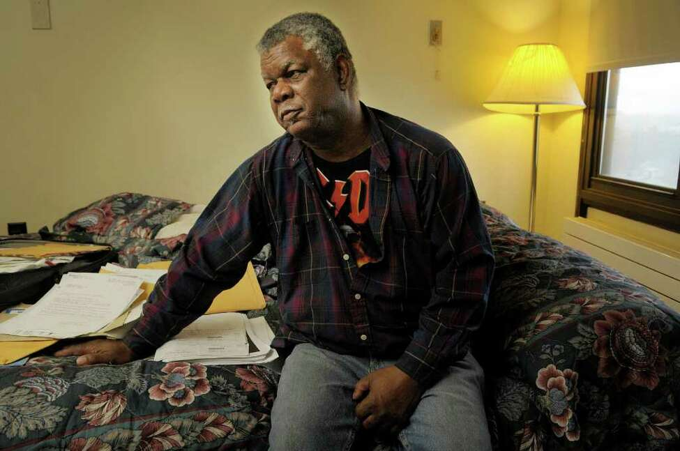 Kenneth Miller sits on his bed in his Albany apartment on Wednesday, Nov. 23, 2011. Miller, a legal permanent resident from Jamaica, is facing deportation due to his prior criminal convictions. (Paul Buckowski / Times Union)