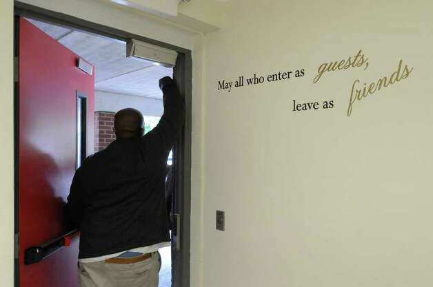 Youth care counselor Chris Evans stands inside the door to Wise Cottage, where the honors residents live, on Tuesday, Aug. 23, 2011, at Berkshire Farm Center in Canaan, N.Y. (Cindy Schultz / Times Union) Photo: Cindy Schultz