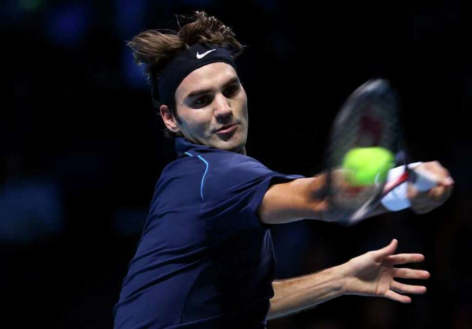 JULIAN FINNEY: GETTY IMAGES ROGER THAT: Roger Federer returns a shot during his 7-6, 6-3 semifinals victory over David Ferrer on Saturday at the ATP World Tour Finals in London. Federer will play Jo-Wilfried Tsonga in today's final - the 100th of Federer's career. Photo: Julian Finney / 2011 Getty Images
