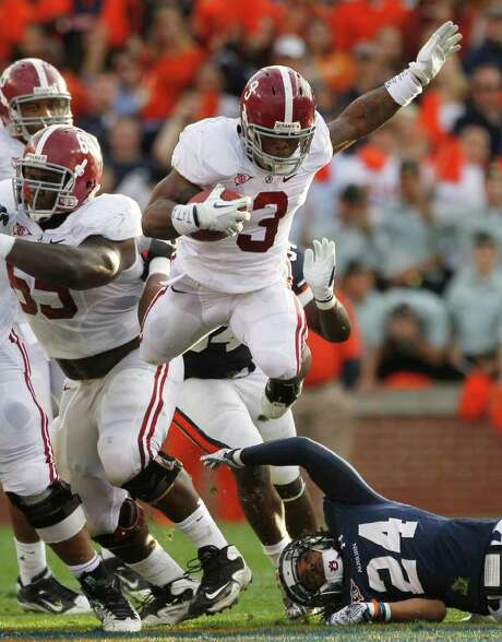 DAVE MARTIN : ASSOCIATED PRESS TROPHY DASH: Trent Richardson (3) enhanced his Heisman hopes by running for 203 yards Saturday. Photo: Dave Martin / AP