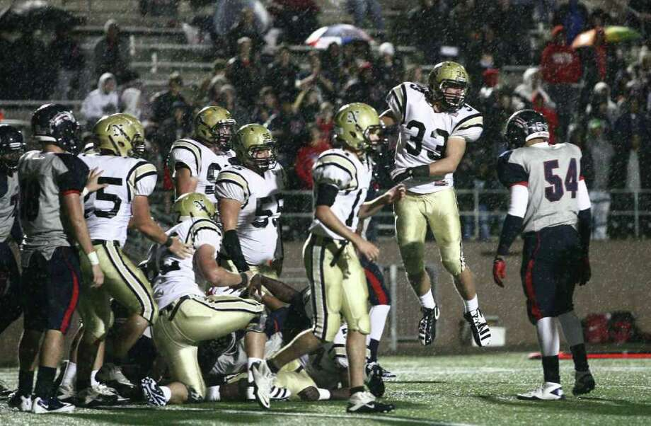 Nederland's Korbin Stampley (33) celebrates his tackle near the Bulldogs' end zone on fourth down during the first half of the 4A Division I Region III semifinal against Dawson, Saturday, November 26, 2011 at Galena Park Stadium in Houston. Photo: Eric Christian Smith, For The Chronicle