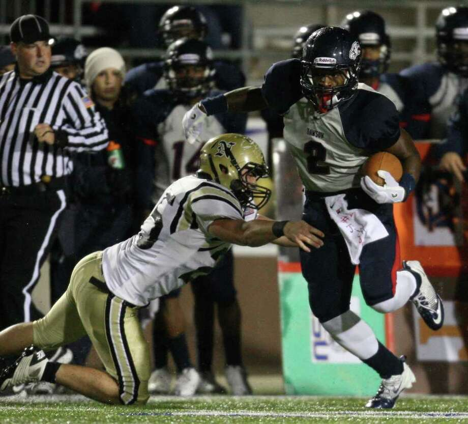 Dawson's James White (2) avoids the tackle of Nederland's Jordan Wood during the first half of the 4A Division I Region III semifinal, Saturday, November 26, 2011 at Galena Park Stadium in Houston. Photo: Eric Christian Smith, For The Chronicle