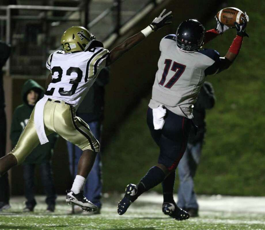 Dawson's Neiman Gilbert (right) makes a touchdown reception over Nederland's Korey Hopkins during the first half of the 4A Division I Region III semifinal, Saturday, November 26, 2011 at Galena Park Stadium in Houston. Photo: Eric Christian Smith, For The Chronicle