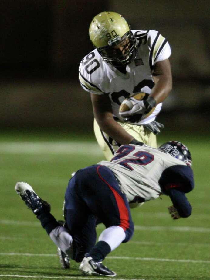 Nederland's De Shawn Washington (90) is tackled by dawson's Andrew Galloway during the first half of the 4A Division I Region III semifinal, Saturday, November 26, 2011 at Galena Park Stadium in Houston. Photo: Eric Christian Smith, For The Chronicle
