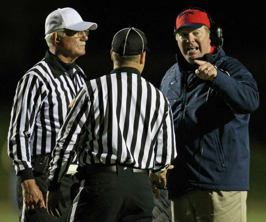 Dawson head coach Eric Wells argues with officials during the first half of the 4A Division I Region III semifinal against Nederland, Saturday, November 26, 2011 at Galena Park Stadium in Houston. Photo: Eric Christian Smith, For The Chronicle