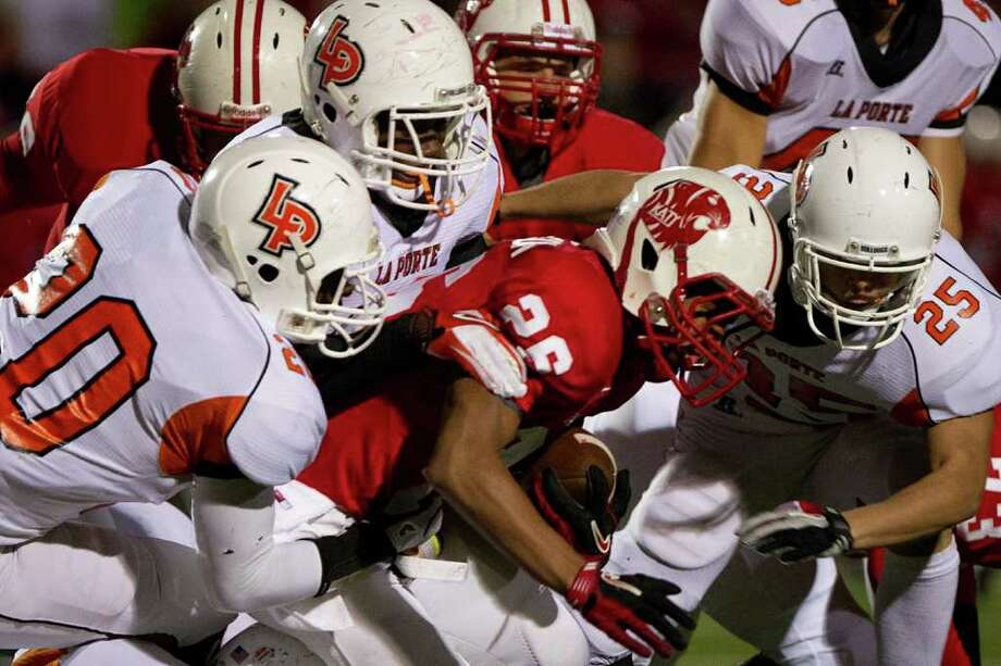 Katy running back Rodney Anderson (26)  is brought down by the La Porte defense during the first half in Class 5A Div. II Region III semifinal high school playoff action at Tully Stadium Saturday, Nov. 26, 2011, in Houston. Photo: Smiley N. Pool, Houston Chronicle / © 2011  Houston Chronicle