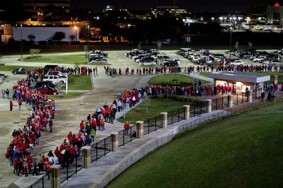 A long line of fans waits to enter Tully Stadium to watch Katy face La Porte in Class 5A Div. II Region III semifinal high school playoff action, Saturday, Nov. 26, 2011, in Houston. Photo: Smiley N. Pool, Houston Chronicle / © 2011  Houston Chronicle