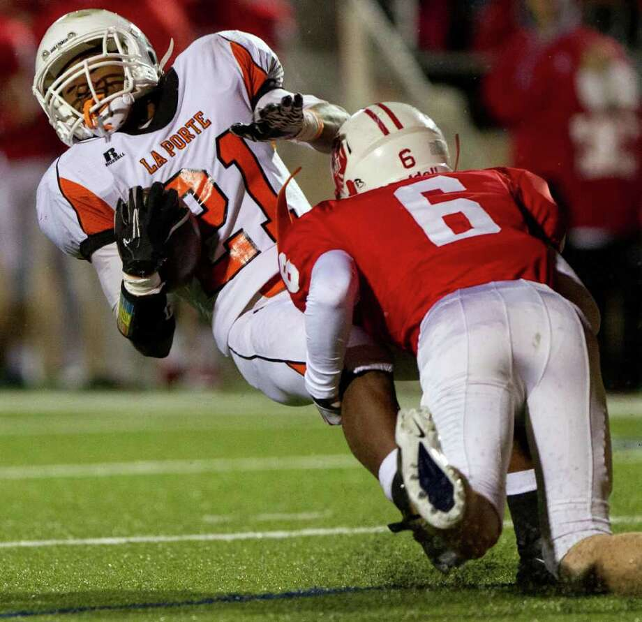 La Porte running back Keith Whitely (21) is stopped by Katy linebacker Brandon Ebrecht (6) during the first half in Class 5A Div. II Region III semifinal high school playoff action at Tully Stadium Saturday, Nov. 26, 2011, in Houston. Photo: Smiley N. Pool, Houston Chronicle / © 2011  Houston Chronicle