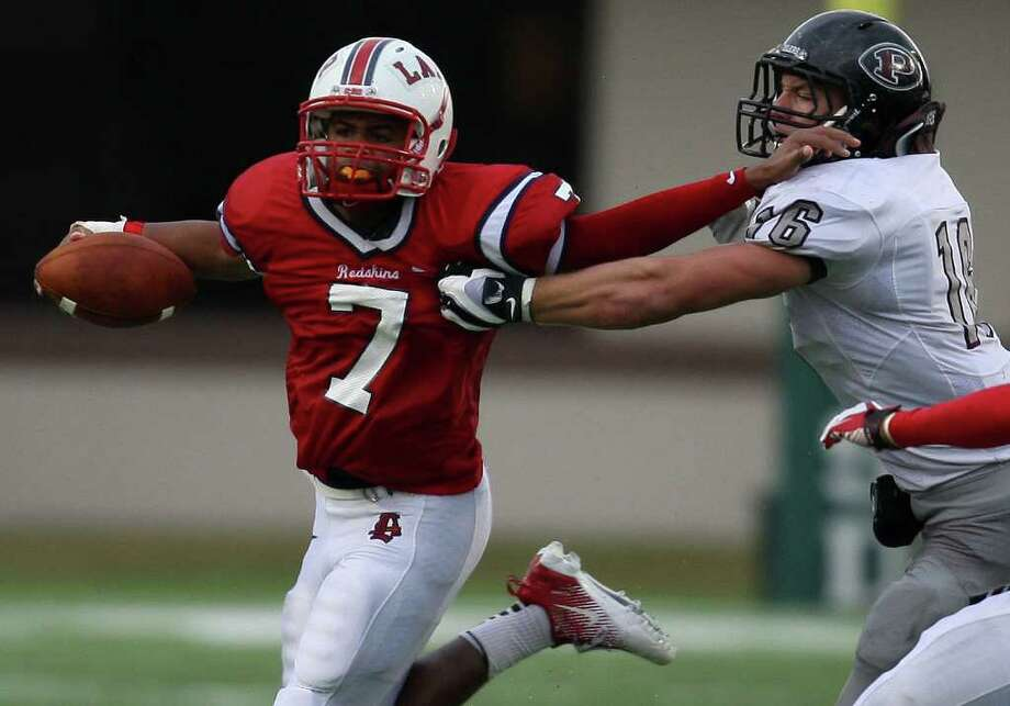 Lamar's Darrell Colbert (7) tries to fend off Pearland's Kendall Ehrlich during the second half of the 5A Division I Region III semifinal, Saturday, November 26, 2011 at Galena Park Stadium in Houston. Photo: Eric Christian Smith, For The Chronicle