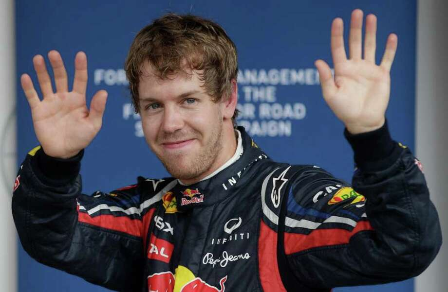 Red Bull driver Sebastian Vettel of Germany waves after making the pole position at the Interlagos race track in Sao Paulo, Brazil, Saturday Nov. 26, 2011. The Brazilian Formula One Grand Prix will take place on Sunday. (AP Photo/Victor R. Caivano) Photo: Victor R. Caivano / AP