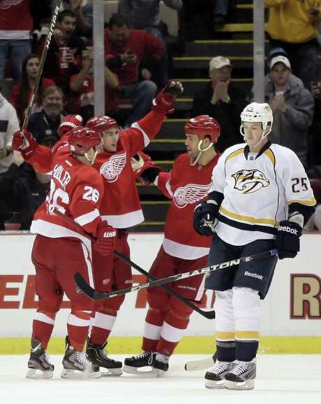 DUANE BURLESON: ASSOCIATED PRESS BIG NIGHT: Detroit's Valtteri Filppula, second from left, celebrates the first of his two goals with teammates Jiri Hudler (26) and Todd Bertuzzi in the Wings' win over the Predators. Photo: Duane Burleson / FR38952 AP
