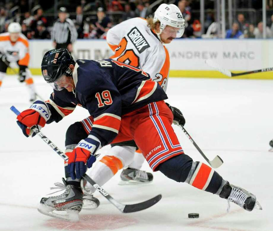 New York Rangers' Brad Richards (19) battles for the puck with Philadelphia Flyers' Claude Giroux during the third period of an NHL hockey game, Saturday, Nov. 26, 2011 at Madison Square Garden in New York.  The Rangers won 2-0. (AP Photo/Bill Kostroun) Photo: Bill Kostroun