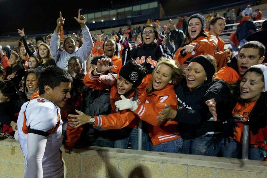 La Porte kicker Eric Medina (6) is a hit with the fans after the Bulldogs defeated Katy in Class 5A Div. II Region III semifinal high school playoff action at Tully Stadium, Saturday, Nov. 26, 2011, in Houston. Medina kicked a 30-yard field goal with 4:34 left to give La Porte a 9-7 victory. Photo: Smiley N. Pool, Houston Chronicle / © 2011  Houston Chronicle