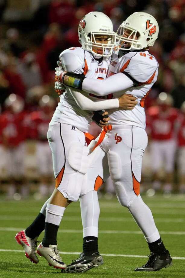 La Porte kicker Eric Medina (6) celebrates with Blake Turlington (87) after kicking a 30-yard field goal with 4:34 left to play against Katy in Class 5A Div. II Region III semifinal high school playoff action at Tully Stadium Saturday, Nov. 26, 2011, in Houston. The field goal proved the difference as La Porte won the game 9-7. Photo: Smiley N. Pool, Houston Chronicle / © 2011  Houston Chronicle