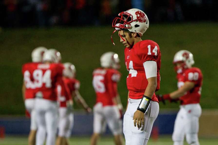 Katy quarterback Brooks Haack (14) walks off the field after throwing an interception with 1:22 to p